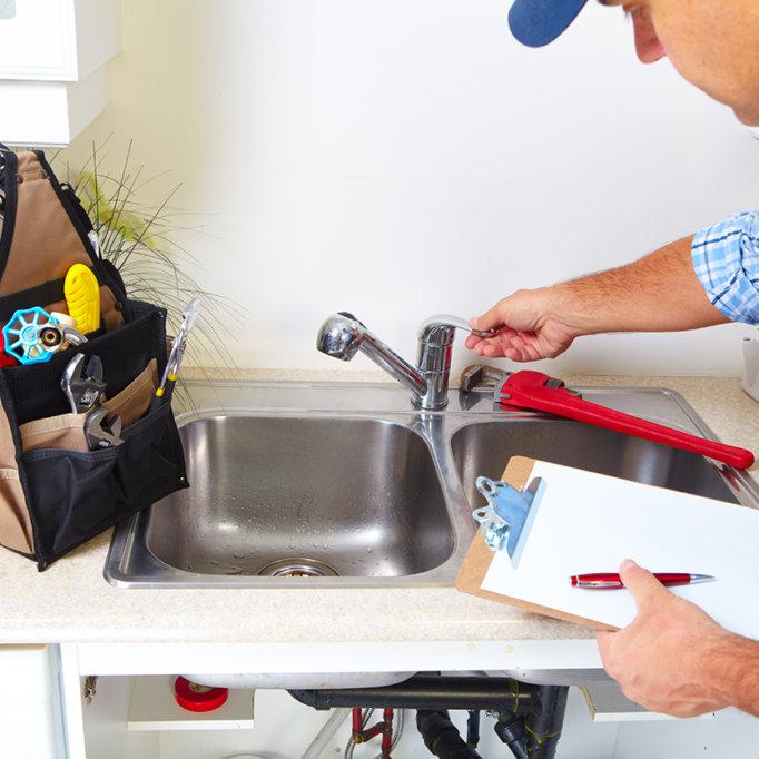 plumber-working-kitchen-sink